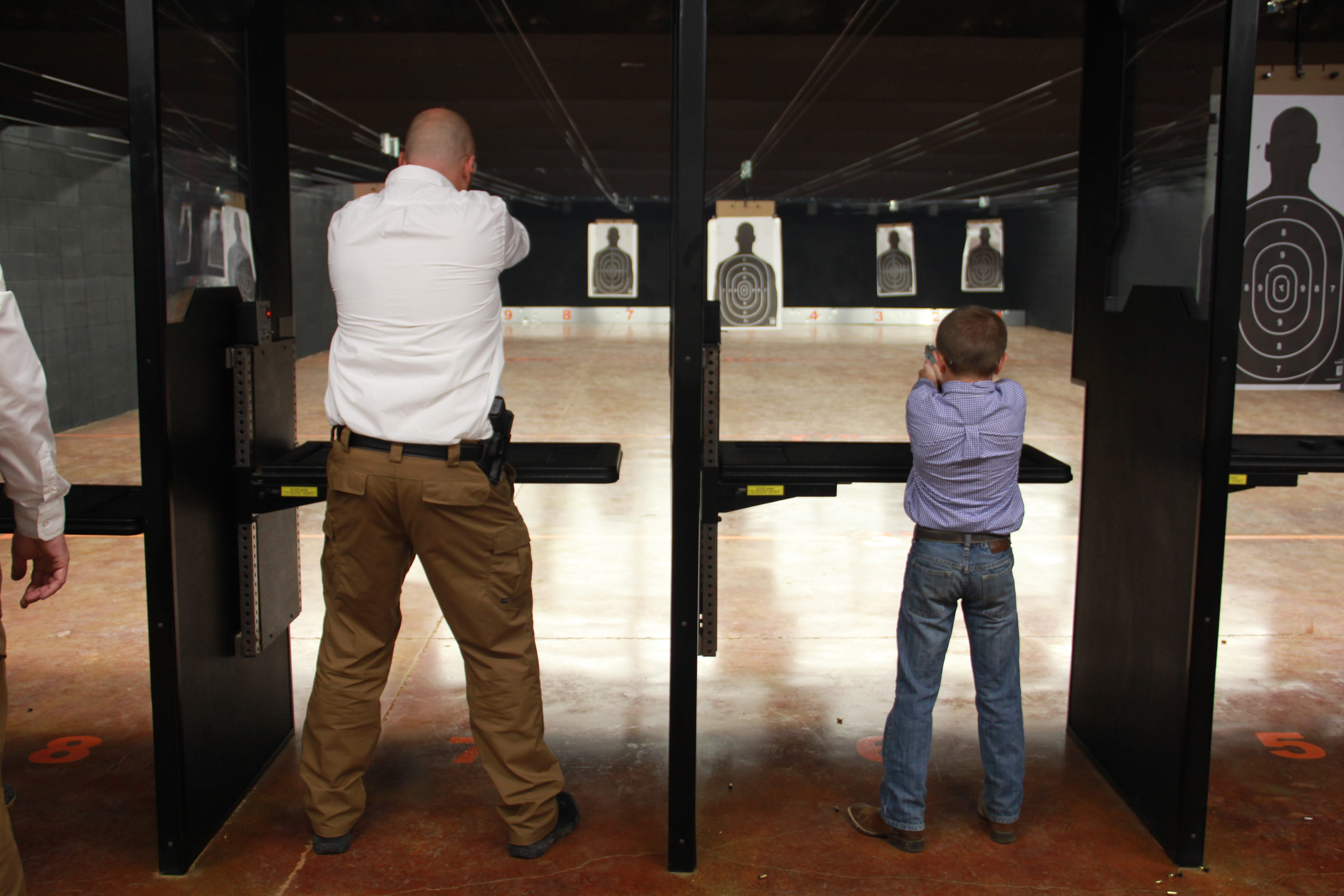 dad shooting with son fathers day indoor shooting range two